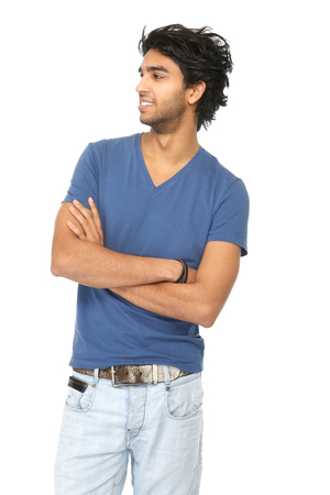 Close up portrait of an attractive young man smiling with arms crossed on isolated white background photo