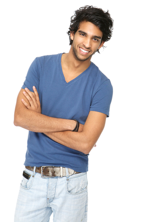 Close up portrait of a handsome young man smiling with arms crossed photo