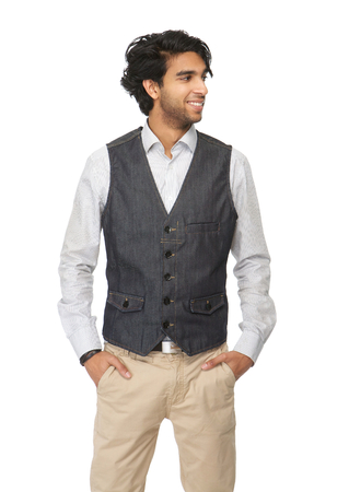 Portrait of a casual young man with hands in pocket isolated on white background photo