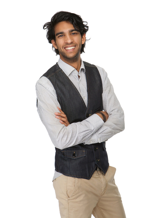Portrait of a charming young man smiling with arms crossed isolated on white photo