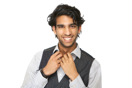 Close up portrait of a casual young man smiling against isolated white background photo
