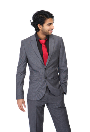 Portrait of an attractive young business man posing on isolated white background photo