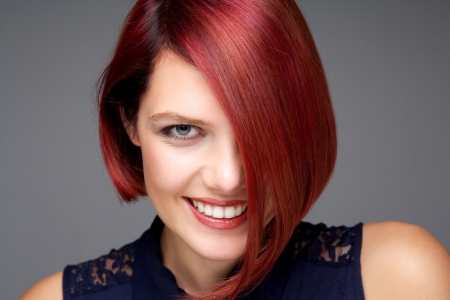 Close up portrait of a beautiful young woman with red hair smiling photo