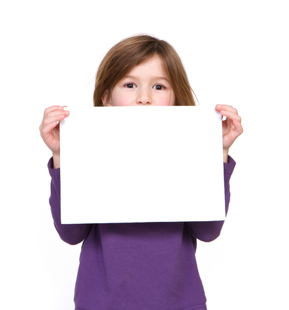 Close up portrait of a young girl holding blank sign photo