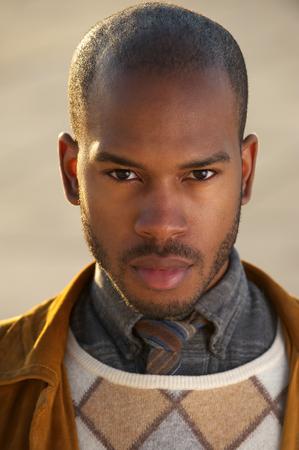 male fashion: Close up portrait of a handsome black male fashion model