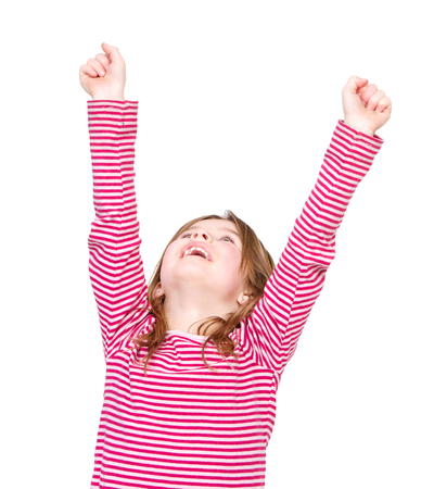 raised arms: Close up portrait of a happy young girl cheering with arms raised on isolated white background Stock Photo