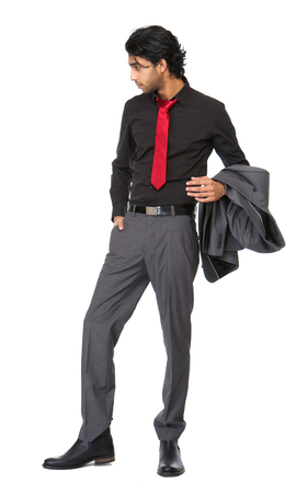 Full length portrait go a young business man standing on isolated white  photo