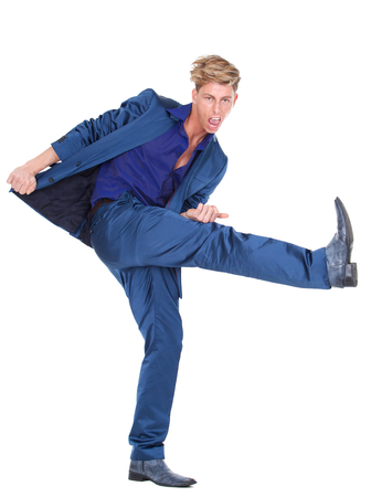 air guitar: Full length portrait of a young man performing air guitar on isolated white background