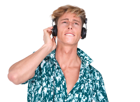 Close up portrait of a young man enjoying music on headphones isolated on white photo