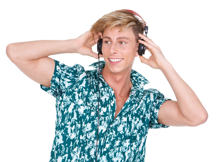 Close up portrait of a young man listening to music on headphones isolated on white background photo