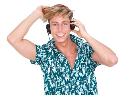 Close up horizontal portrait of a smiling young man listening to music with headphones photo
