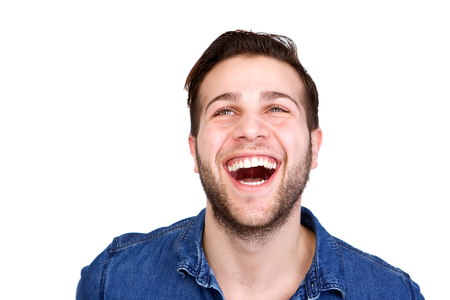 enthusiastic: Close up horizontal portrait of a cheerful young man laughing and looking up isolated on white background Stock Photo