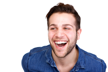 Close up horizontal portrait of a handsome young man laughing on isolated white background Stock fotó