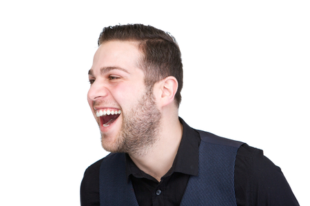Horizontal profile portrait of a handsome young man laughing on isolated white background photo