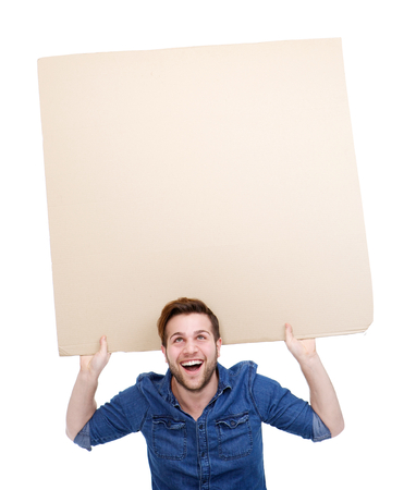Close up portrait of one young man smiling and holding up blank poster sign on isolated white background photo