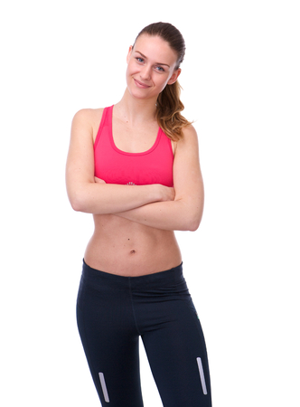 sport clothes: Portrait of a beautiful athletic young woman in sport clothes posing on isolated white background