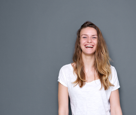 fray: Close up portrait of a beautiful young woman laughing on fray background