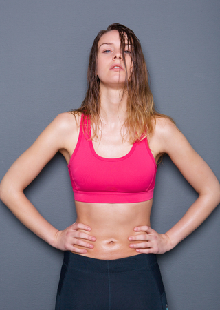 Close up portrait of a sports woman after workout with sweat on body Stock Photo