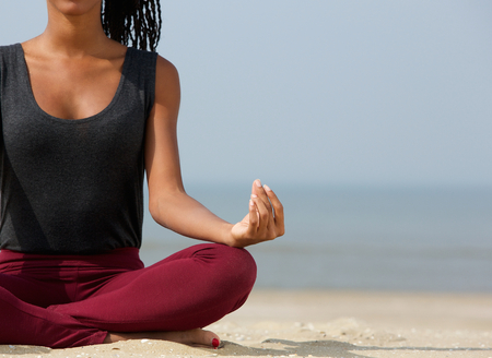 yoga girl: Close up portrait of a young woman in lotus position with yoga hands at the beach