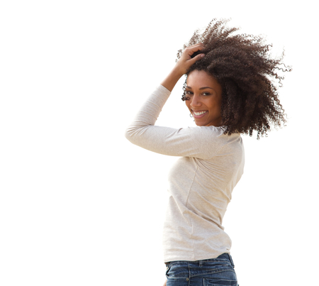 Portrait of a beautiful smiling young african american woman with hair in hair  photo