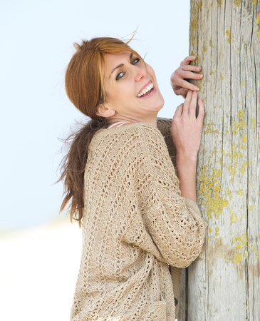 middle aged woman smiling: Close up portrait of a cheerful middle aged woman smiling outdoors