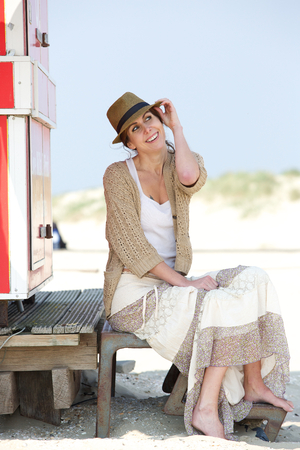 middle aged woman smiling: Portrait of a happy middle aged woman smiling at the beach