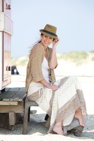 middle aged woman smiling: Portrait of a cheerful middle aged woman smiling outdoors with hat