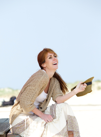 middle aged woman smiling: Portrait of a carefree middle aged woman smiling outdoors