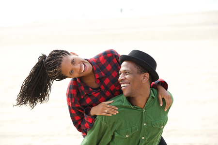 Portrait of a beautiful black couple smiling outdoors photo