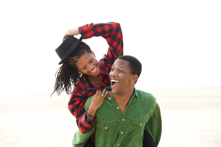 african american couple: Portrait of a playful african american couple smiling outdoors