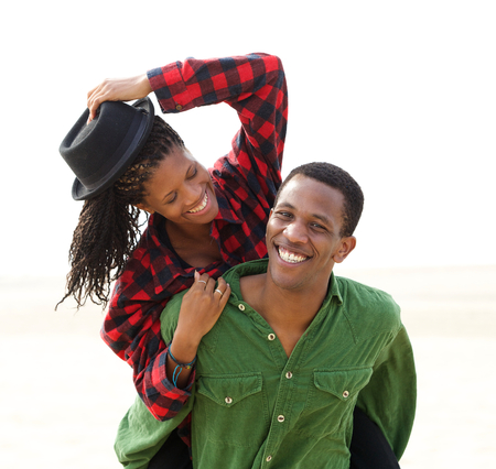 couples outdoors: Portrait of a cheerful young couple smiling together outdoors  Stock Photo