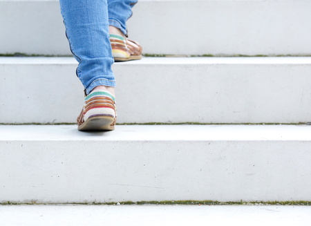 Female walking upstairs on stone staircase outdoors photo