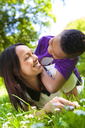 single parents: Close up portrait of a mother and son smiling outdoors