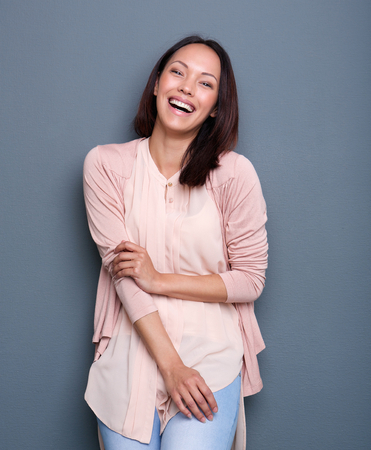 fray: Portrait of a beautiful young mixed race woman smiling on fray background