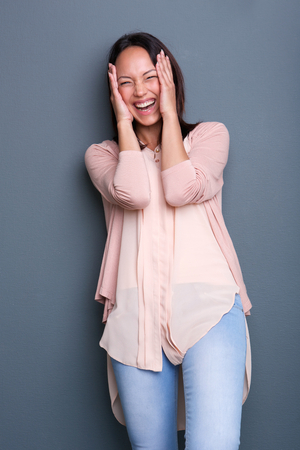 embarrassed: Portrait of a young woman laughing with embarrassed expression  Stock Photo