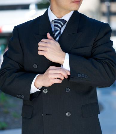 Close up portrait of a businessman adjusting cuff  Stock Photo
