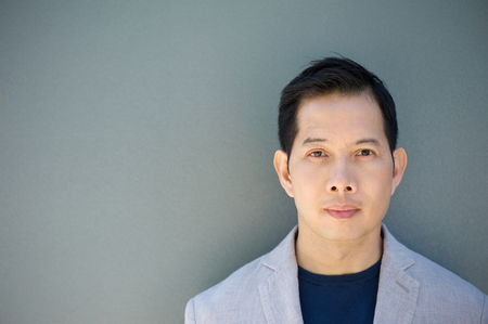 Close up horizontal portrait of an asian man with serious expression Stock Photo