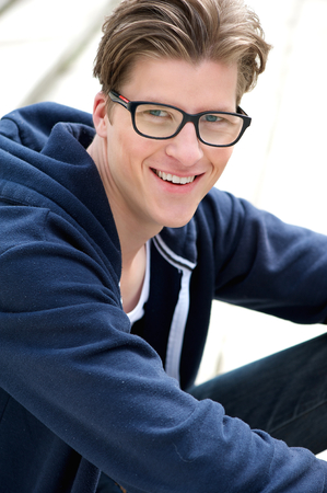 cute guy: Close up portrait of a cute guy smiling with glasses