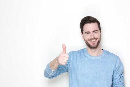 thumbs up man: Portrait of a cheerful man posing with thumbs up sign Stock Photo
