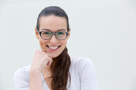 Close up portrait of a beautiful young woman wearing glasses Imagens