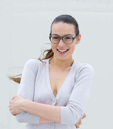 Close up portrait of a happy young woman with glasses photo