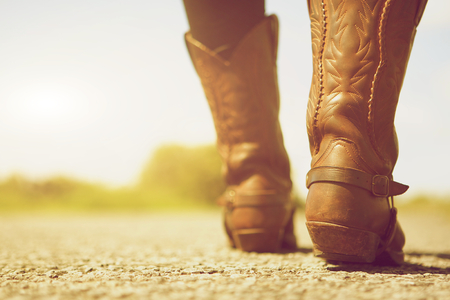 1: Close up low angle female with cowboy boots Stock Photo