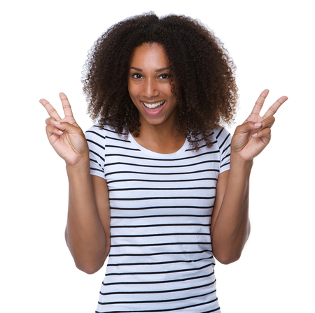 Close up portrait of a happy young woman with peace sign Stock Photo