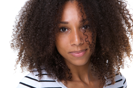 Close up portrait of a beautiful african american woman with serious expression photo