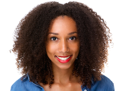 Close up portrait of a beautiful african girl smiling on isolated white background