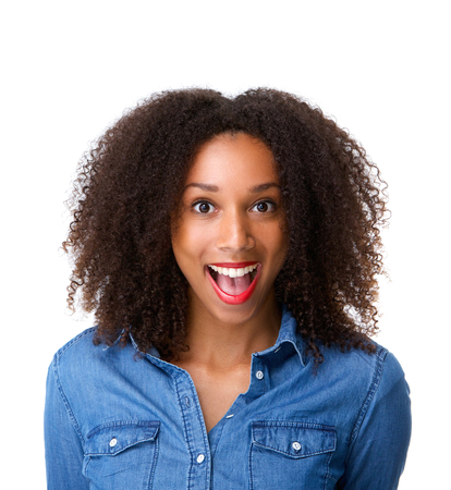 Close up portrait of a young woman with surprised expression on face