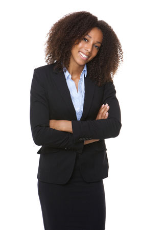 Portrait of a young african american business woman smiling with arms crossed  Stock Photo