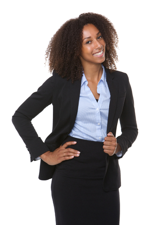 Portrait of a happy young black business woman posing on isolated white background photo
