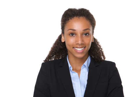 Close up portrait of a young african american business woman smiling on isolated white background