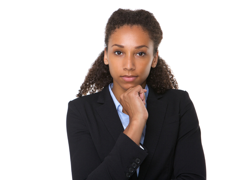 Close up portrait of a serious young business woman posing on isolated white background Imagens